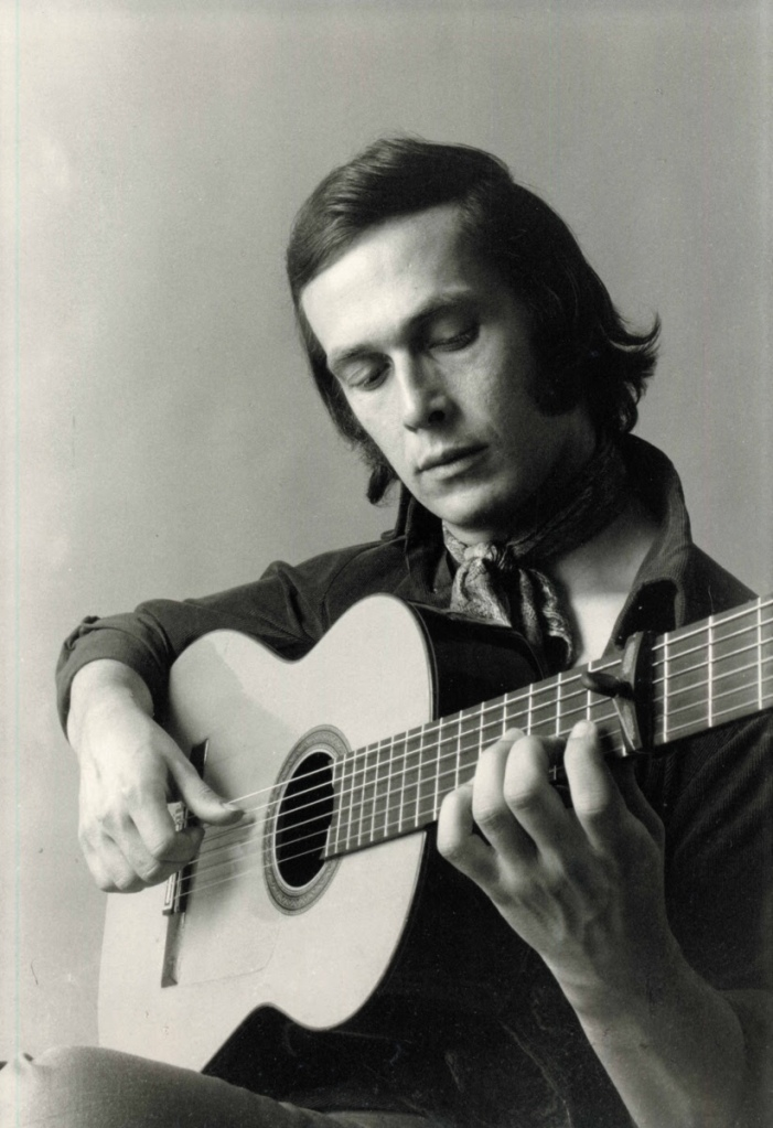 Paco de Lucía holding his flamenco guitar