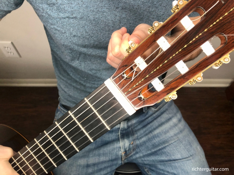 tune down your classical guitar strings before putting new ones on