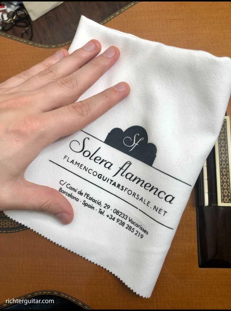 Cleaning classical guitar with a soft cloth from Solera Flamenca