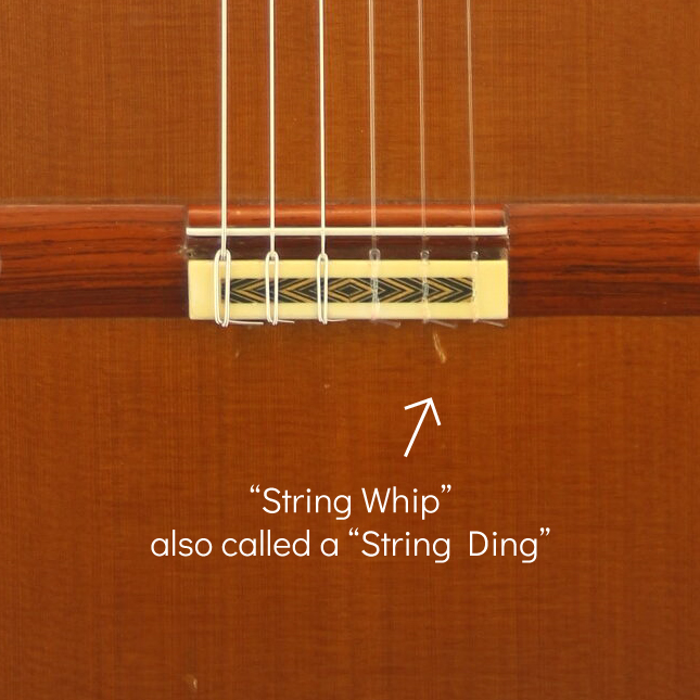Classical guitar String whip example, also called a string ding or dent below the bridge